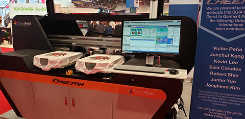Omni Print Cheetah Dtg Printer that we took a picture of at the SGIA Show.